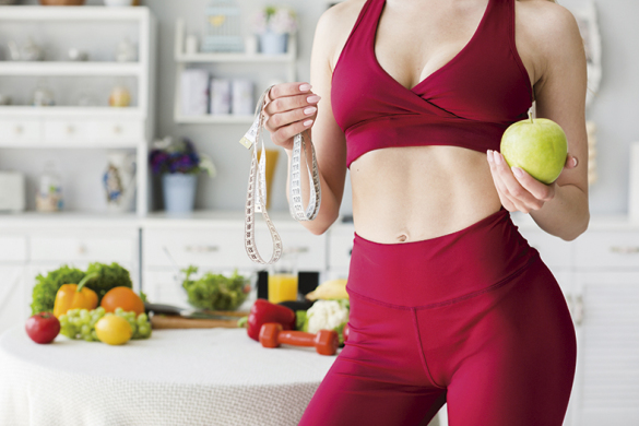 diet-concept-with-sporty-woman-kitchen